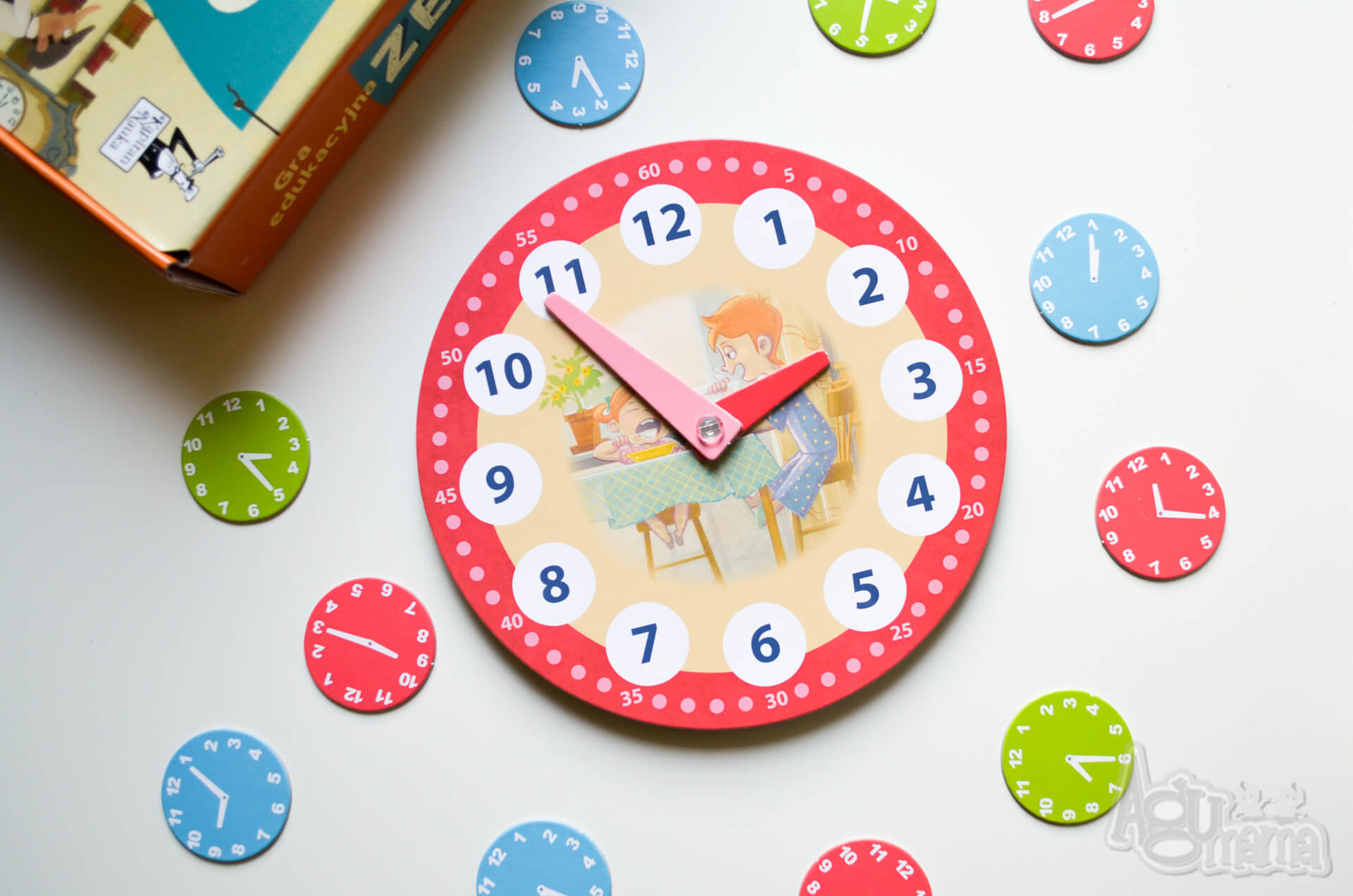 gra edukacyjna zegar z czerwoną tarczą